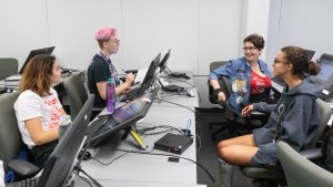 SADI 2019 students working and chatting in a computer lab.