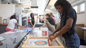 SADI students working in the printmaking classroom.