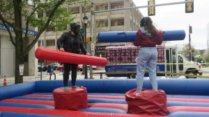 Inflatable jousting on Fall Convocation Day.