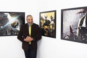 Tim Fielder standing in front of artwork