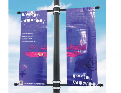 Photo of purple banners with details of Preston Paperboy's artwork advertising an Artist Lecture at the Franklin Institute by Natalie Cosentini
