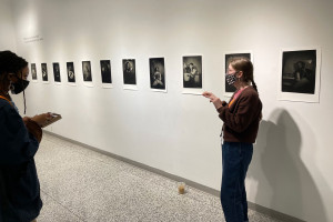 MFA student Elizabeth Kelly presenting her photo exhibit in the Galleries at Moore