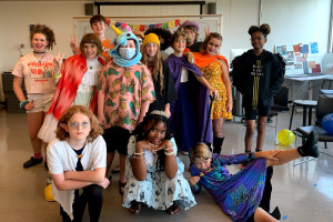 Group photo of Young Artists Workshop students wearing costumes