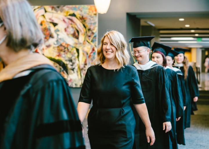 Art Education graduates and director Lauren Stichter walking at the Art Education 2021 Commencement