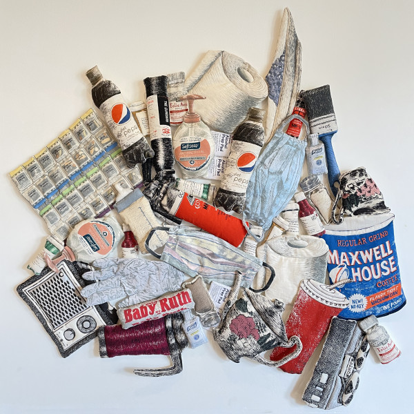 Photo of Kay Healy's soft sculpture Pile 2 with images of soda bottles, toilet paper rolls, soap bottles, paint brushes, etc.