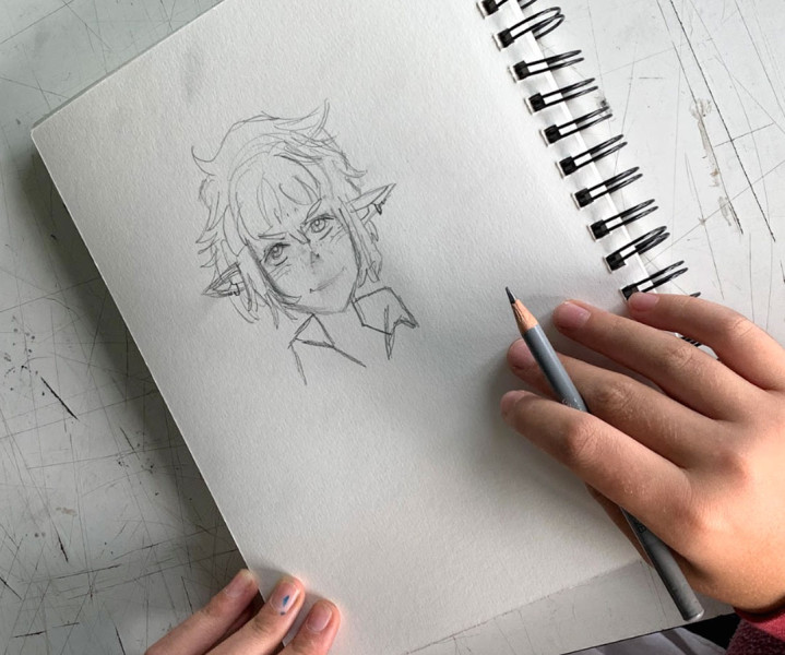 Overhead photo of a YAW student's character design sketch